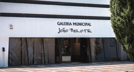 Albufeira, Portugal - May 4, 2018: architectural detail of the municipal auditorium and the municipal gallery Joao Bailote next to the town hall on a spring day