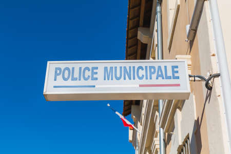 Police Municipale (municipal police) sign on the storefront of a local police station in a small town