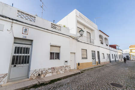 Quarteira, Portugal - February 27, 2020: Architecture detail of typical small houses in the city center on a winter day