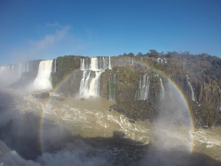 Iguazu Falls or Iguacu Falls are waterfalls of the Iguazu River on the border of the Argentine province of Misiones and the Brazilian state of Parana. Together, they make up the largest waterfall system in the world. The falls divide the river into the upper and lower Iguazu.