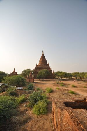 Old Bagan temple and ruins in Myanmar. Bagan is an ancient city and a UNESCO World Heritage Site located in the Mandalay Region of Myanmar. From the 9th to 13th centuries, the city was the capital of the Pagan Kingdom, the first kingdom that unified the regions that would later constitute modern Myanmar.