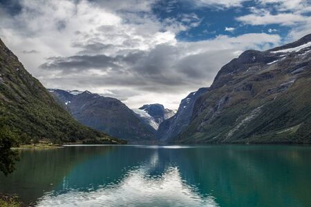 Lovatnet is a lake in the municipality of Stryn in Sogn og Fjordane county, Norway. It is located about 2 kilometres southeast of the village of Loen and about 6 kilometres east of the village of Olden. The lake lies just 2 kilometres southwest of the mountain Skala.