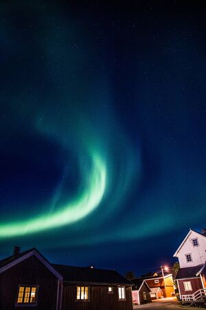Northern lights above Reine in Lofoten islands in Norway