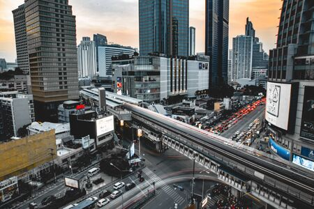 Asoke intersection and sky train station in Bangkok Thailand. Terminal 21 mall and grande centre point, bts asoke and traffic.