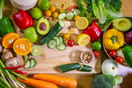 Healthy food clean eating selection: fruit, vegetable, seeds, superfood, leaf vegetable and mediterranean dishes. Detox and clean diet. Foods high in vitamins, minerals and antioxidants.