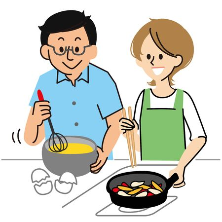 A young couple cooking in the kitchen