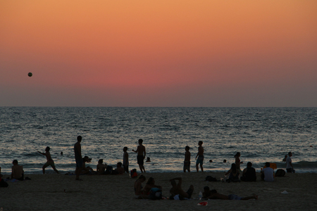 Beach sunset with people