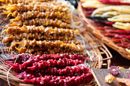 lounging: Churchkhelas lounging on the bazaar. Georgian National sweetness. Nuts in the grape juice.
