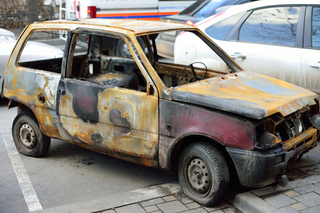 burned car on the street, concept riots and terrorism