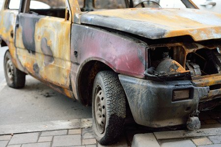 the front of the burned-out compact car