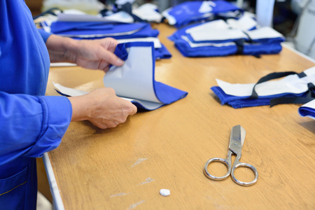 garments: Garment factory. Working with sewing patterns. The distribution of patches for garments. Stock Photo