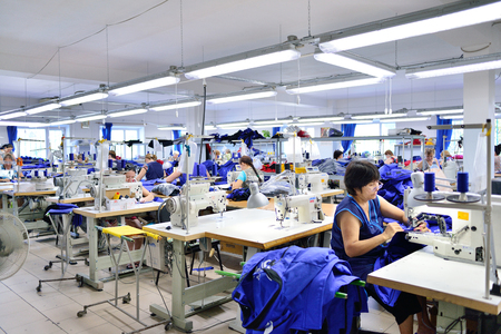 GUKOVO, RUSSIA - SEPTEMBER, 2016: Workers work in a garment factory