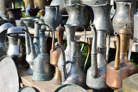 ewer: Old oriental antiques barass vases on street market.