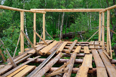 began construction of a wooden house in the woods Stock Photo
