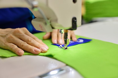 women's hands: Tailoring Process - Womens hands behind her sewing