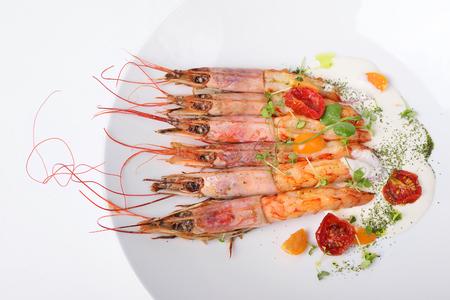 langoustine prawns grilled, white background. Top view Stock Photo
