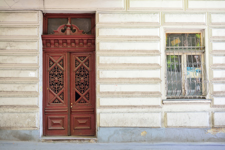 Old carved wooden door in a house Tbilisi Stock Photo