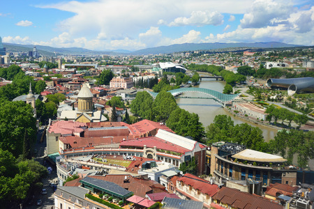 Top view of the main attractions of Tbilisi. The Kura River, bridge of the world, monasteries. Editorial