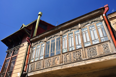 noteworthy: Colorful balcony with carved wooden accents. Tbilisi Tourist Center.