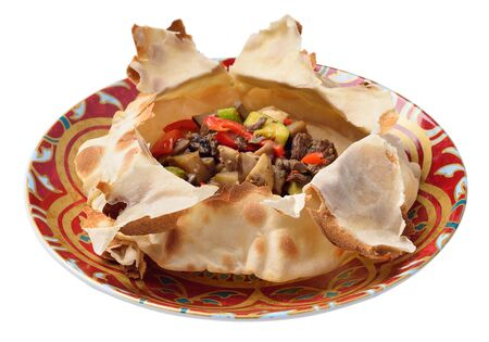 veal with vegetable salad in a warm tortilla. Eastern dish. Isolated.