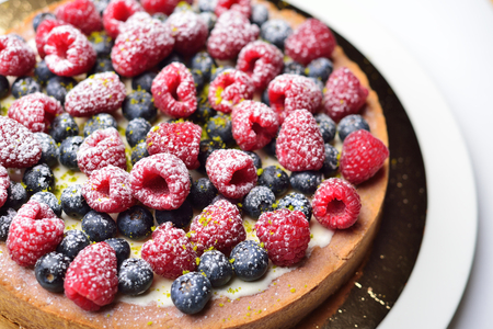 cake with raspberries and blueberries Stock Photo