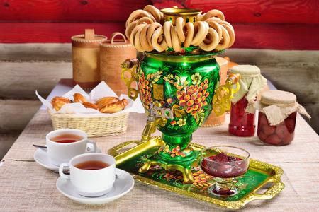 Russian character - a samovar. A bunch of bagels. Homemade jam. Patties. Russian food. 版權商用圖片