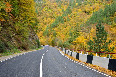 Autumn road in the mountains Stock Photo