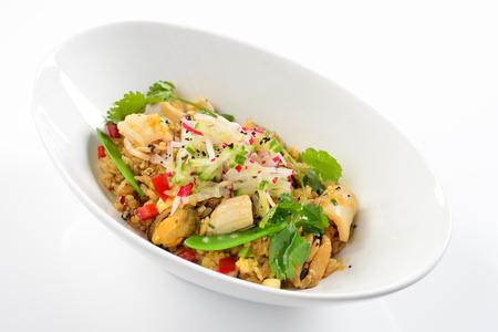 Asian fried rice nasi goreng with seafood, and fish baso