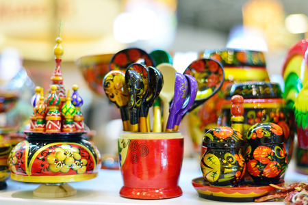 Russian traditional souvenirs, wooden spoons, figurines.
