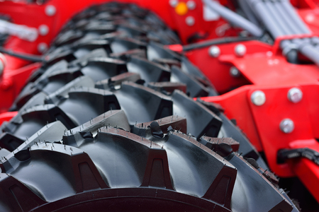 Rows of new tires agricultural machines. Stock Photo