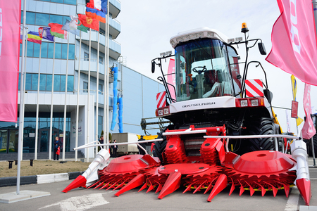 ROSTOV-ON-DON, RUSSIA - MARCH, 2017: specialized exhibition Agricultural Machinery and Equipment. Stand on open area. Combine Plant Rostselmash Editorial
