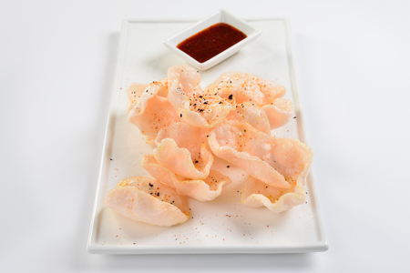 shrimp chips with spicy soy sauce. White background. menu concept.