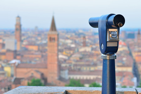 Telescope mounted on top Verona observation deck. View to Verona, Italy.