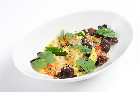 sauteed: Chinese salad with mushrooms and cucumber. White background, menu concept. Stock Photo