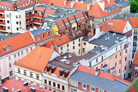 Tiled roofs in the residential area of the European city. Poland, Wroclaw.
