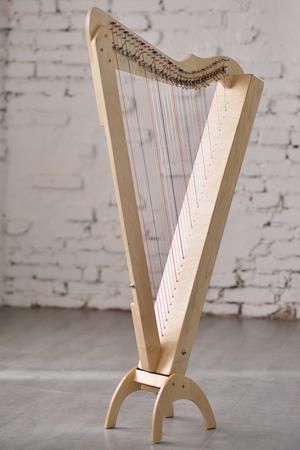 Light harp on a brick wall background.