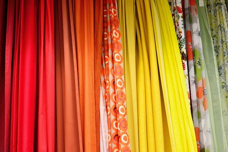 A wide variety of colorful curtain textiles. Stock Photo