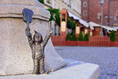 WROCLAW, POLAND - JUNE, 2017: Wroclaw, a miniature statue of a gnome on the main square of the city. A dwarf with a guitar. The concept of music. 写真素材