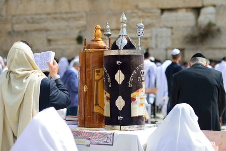JERUSALEM, ISRAEL - APRIL 2017:  Jewish man celebrate Simchat Torah. Simchat Torah is a celebratory Jewish holiday marks the completion of the annual Torah reading cycle