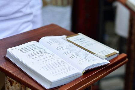 JERUSALEM, ISRAEL - APRIL 2017: Talmud Tora Tanach Books lying on the table during the prayer in the Bar Mitzwa Ceremony at the Western Wall Jerusalem (Kotel)