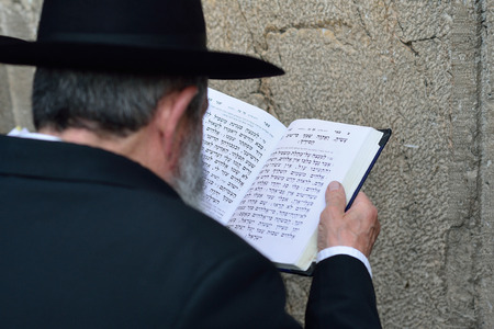JERUSALEM, ISRAEL - APRIL 2017: Jewish hasidic prayer, the Western Wall, The Wailing Wall of the Place of Weeping is an ancient limestone wall in the Old City of Jerusalem. Editorial