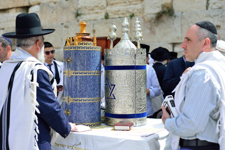 simchat torah: JERUSALEM, ISRAEL - APRIL 2017:  Jewish man celebrate Simchat Torah. Simchat Torah is a celebratory Jewish holiday marks the completion of the annual Torah reading cycle
