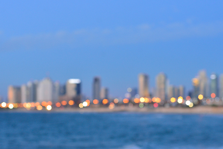 Blurred city lights with bokeh effect reflected on water Stock Photo