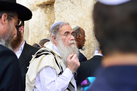 JERUSALEM, ISRAEL - APRIL 2017: Jewish hasidic pray a the Western Wall, Wailing Wall the Place of Weeping is an ancient limestone wall in the Old City of Jerusalem. Editorial