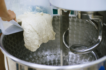 Machine for kneading bread in a bakery oven