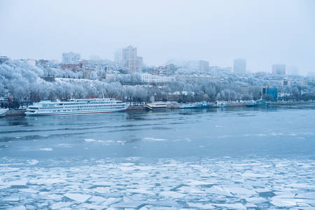 Winter city. Day. Pierce, the water in the river is frozen. Rostov-on-Don, South Russia.