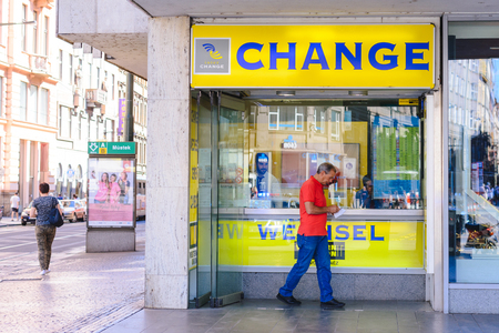 PRAGUE, CZECH REPUBLIC - MAY 2017: Travel currency exchange counter service. Money exchange shop in Prague for visitor and tourist.