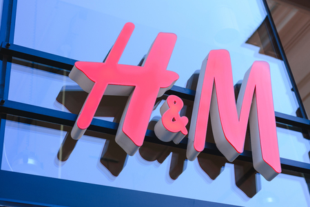 PRAGUE, CZECH REPUBLIC - MAY 2017: close up shot of H&M logo. H & M Hennes & Mauritz AB is a Swedish multinational retail-clothing company, known for its fast-fashion clothing