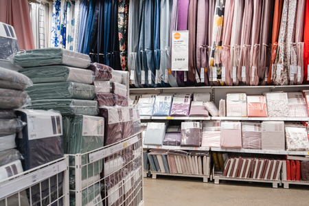 ST. PETERSBURG, RUSSIA - MARCH, 2019: Interior of elegant IKEA furniture store with curtains for Windows and home textiles.