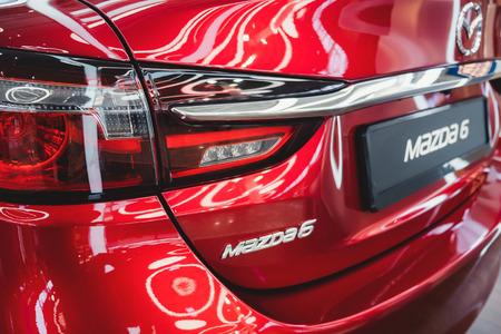 ST. PETERSBURG, RUSSIA - MARCH, 2019: Logo of Mazda car model 6, Modern design of red car and tail light. Redakční